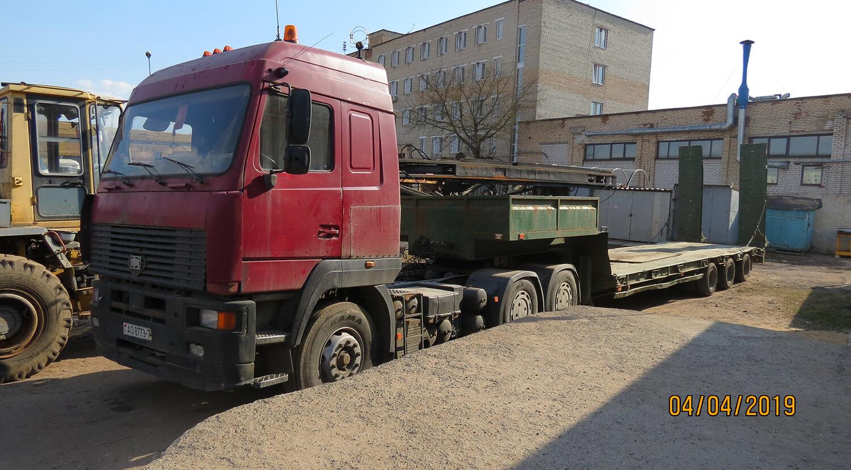 1 фото Тягач МАЗ-МАН 648368 с полуприцепом-площадкой