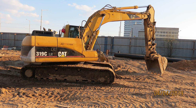 3 фото Экскаватор CAT 319C